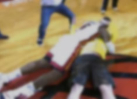 LeBron Tackles Heat Fan Who Hits $75K Shot
