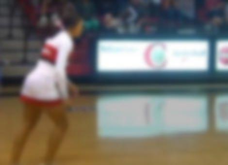 Cheerleader Makes Half-Court Flip Shot
