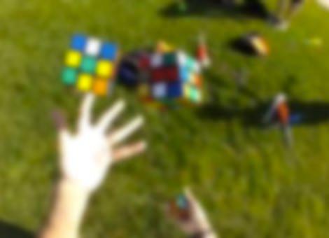 Solving Three Rubik's Cubes While Juggling