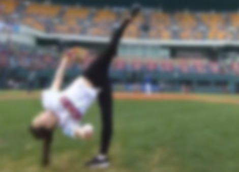Rhythmic Gymnast's First Pitch