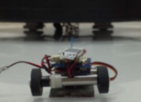 Microrobots Tow a Car