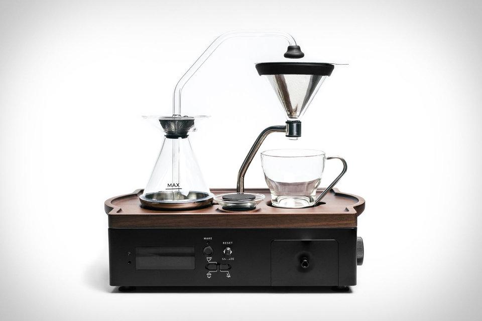 Barisieur brewing alarm clock 465 having a warm cup of